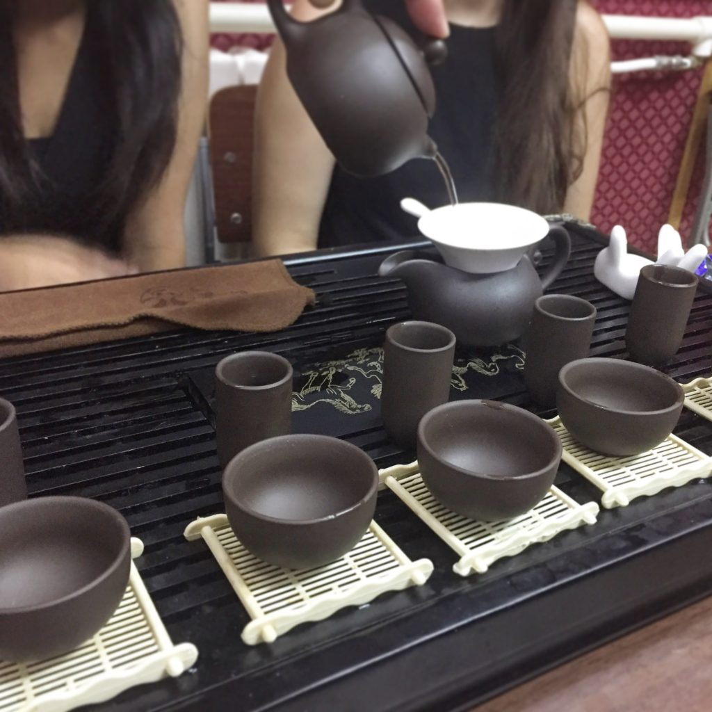 Camp counsellors enjoying a traditional tea ceremony in Beijing