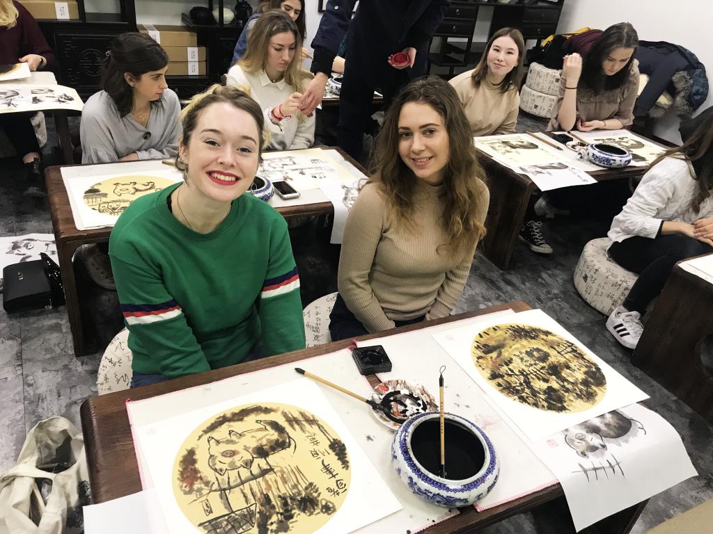 Homestay tutors in Hangzhou enjoying a fun Chinese painting cultural class!