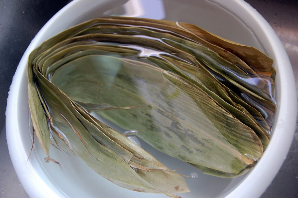 Preparing leaves/ rice
